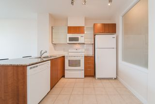 "Photo 3: 408 4078 KNIGHT Street in Vancouver: Knight Condo for sale in ""KING EDWARD VILLAGE"" (Vancouver East)  : MLS®# R2367118"