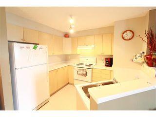 Photo 5: 2316 2600 66 Street NE in Calgary: Pineridge Condo for sale : MLS®# C4016861