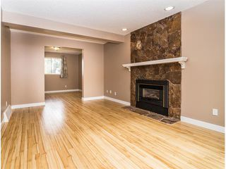 Photo 6: 1240 MEADOWBROOK Drive SE: Airdrie House for sale : MLS®# C4031774