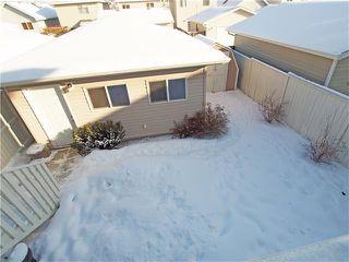 Photo 2: 178 BRIDLEGLEN Road SW in Calgary: Bridlewood House for sale : MLS®# C4103695