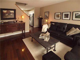 Photo 7: 178 BRIDLEGLEN Road SW in Calgary: Bridlewood House for sale : MLS®# C4103695