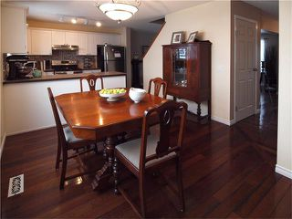 Photo 9: 178 BRIDLEGLEN Road SW in Calgary: Bridlewood House for sale : MLS®# C4103695
