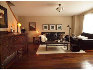 Photo 6: 178 BRIDLEGLEN Road SW in Calgary: Bridlewood House for sale : MLS®# C4103695