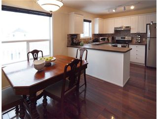 Photo 11: 178 BRIDLEGLEN Road SW in Calgary: Bridlewood House for sale : MLS®# C4103695