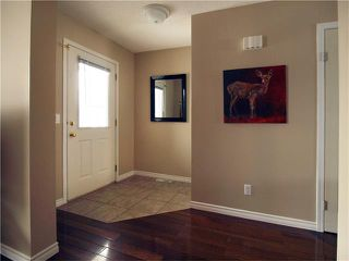 Photo 4: 178 BRIDLEGLEN Road SW in Calgary: Bridlewood House for sale : MLS®# C4103695