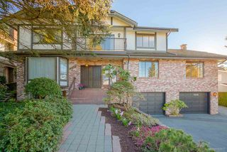 "Photo 1: 7505 LAMBETH Drive in Burnaby: Buckingham Heights House for sale in ""BUCKINGHAM HEIGHTS"" (Burnaby South)  : MLS®# R2161414"