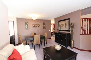 Photo 5: 218 ARBOUR RIDGE Park NW in Calgary: Arbour Lake House for sale : MLS®# C4186879