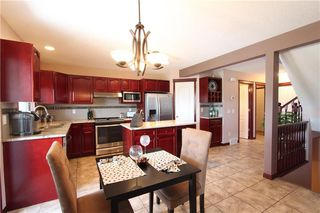 Photo 10: 218 ARBOUR RIDGE Park NW in Calgary: Arbour Lake House for sale : MLS®# C4186879