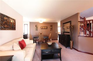 Photo 4: 218 ARBOUR RIDGE Park NW in Calgary: Arbour Lake House for sale : MLS®# C4186879