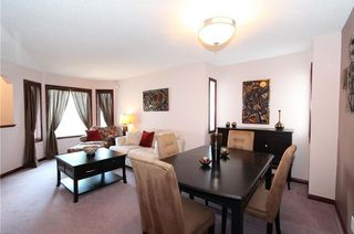 Photo 8: 218 ARBOUR RIDGE Park NW in Calgary: Arbour Lake House for sale : MLS®# C4186879