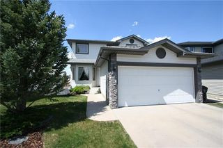 Photo 2: 218 ARBOUR RIDGE Park NW in Calgary: Arbour Lake House for sale : MLS®# C4186879