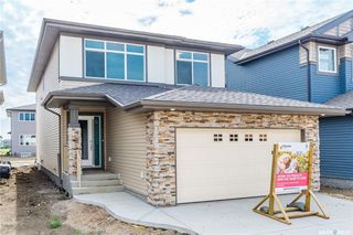 Photo 1: 220 Dagnone Lane in Saskatoon: Brighton Residential for sale : MLS®# SK746511