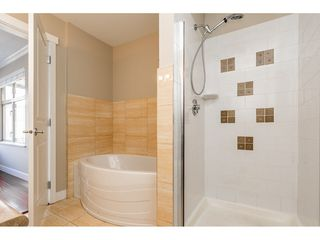 """Photo 16: 403 300 KLAHANIE Drive in Port Moody: Port Moody Centre Condo for sale in """"TIDES"""" : MLS®# R2345575"""