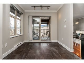 """Photo 12: 403 300 KLAHANIE Drive in Port Moody: Port Moody Centre Condo for sale in """"TIDES"""" : MLS®# R2345575"""