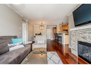 """Photo 5: 403 300 KLAHANIE Drive in Port Moody: Port Moody Centre Condo for sale in """"TIDES"""" : MLS®# R2345575"""