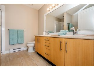 """Photo 14: 403 300 KLAHANIE Drive in Port Moody: Port Moody Centre Condo for sale in """"TIDES"""" : MLS®# R2345575"""