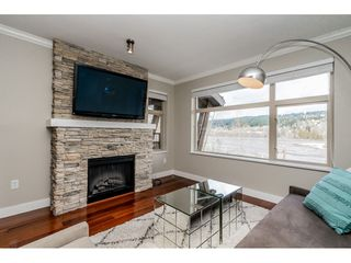 """Photo 2: 403 300 KLAHANIE Drive in Port Moody: Port Moody Centre Condo for sale in """"TIDES"""" : MLS®# R2345575"""