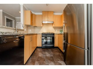 """Photo 11: 403 300 KLAHANIE Drive in Port Moody: Port Moody Centre Condo for sale in """"TIDES"""" : MLS®# R2345575"""