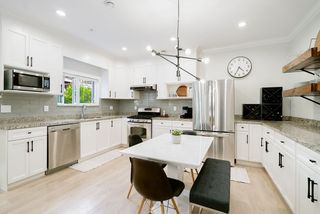 Photo 3: 1410 E 1ST AVENUE in Vancouver: Grandview Woodland House 1/2 Duplex for sale (Vancouver East)  : MLS®# R2402458