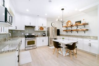 Photo 2: 1410 E 1ST AVENUE in Vancouver: Grandview Woodland House 1/2 Duplex for sale (Vancouver East)  : MLS®# R2402458
