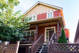 Photo 1: 1410 E 1ST AVENUE in Vancouver: Grandview Woodland House 1/2 Duplex for sale (Vancouver East)  : MLS®# R2402458