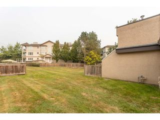 """Photo 17: 102 17718 60 Avenue in Surrey: Cloverdale BC Townhouse for sale in """"CLOVER PARK GARDENS"""" (Cloverdale)  : MLS®# R2498057"""