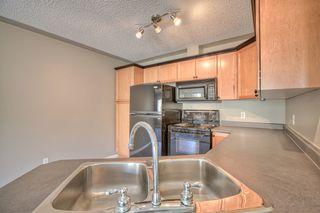 Photo 4: 316 369 ROCKY VISTA Parkway NW in Calgary: Rocky Ridge Ranch Condo for sale : MLS®# C4003686