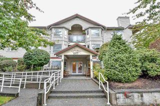 "Photo 1: 209 5977 177B Street in Surrey: Cloverdale BC Condo for sale in ""THE STETSON"" (Cloverdale)  : MLS®# R2111705"