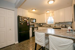"Photo 6: 404 2733 ATLIN Place in Coquitlam: Coquitlam East Condo for sale in ""ATLIN COURT"" : MLS®# R2232992"