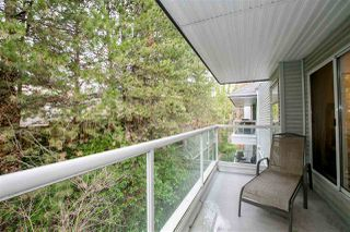 "Photo 17: 404 2733 ATLIN Place in Coquitlam: Coquitlam East Condo for sale in ""ATLIN COURT"" : MLS®# R2232992"