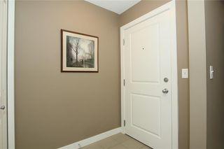 Photo 3: 2402 625 GLENBOW Drive: Cochrane Apartment for sale : MLS®# C4191962