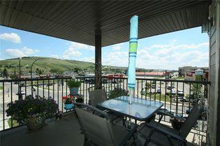 Photo 1: 2402 625 GLENBOW Drive: Cochrane Apartment for sale : MLS®# C4191962
