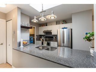 """Photo 7: 407 20277 53RD Avenue in Langley: Langley City Condo for sale in """"THE METRO II"""" : MLS®# R2466451"""