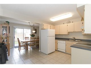 Photo 5: 250 BALMORAL Place in Port Moody: North Shore Pt Moody Townhouse for sale : MLS®# V1054135