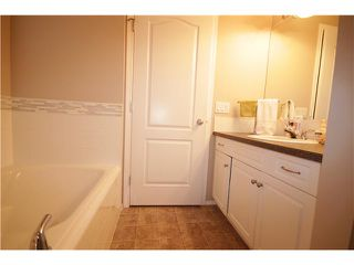 Photo 12: 201 800 YANKEE VALLEY Boulevard SE: Airdrie Townhouse for sale : MLS®# C3643287