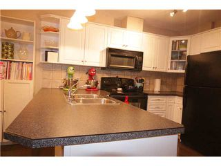 Photo 4: 201 800 YANKEE VALLEY Boulevard SE: Airdrie Townhouse for sale : MLS®# C3643287