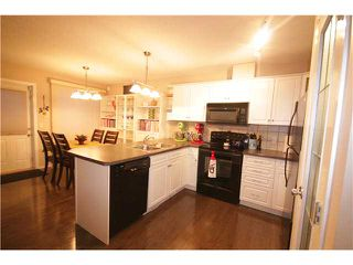Photo 3: 201 800 YANKEE VALLEY Boulevard SE: Airdrie Townhouse for sale : MLS®# C3643287