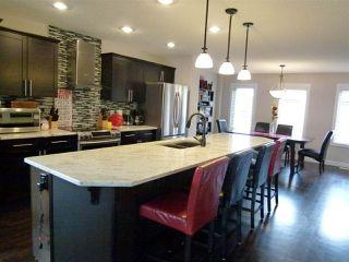 Photo 7: 3080 KESWICK Way in Edmonton: Zone 56 Attached Home for sale : MLS®# E4142415