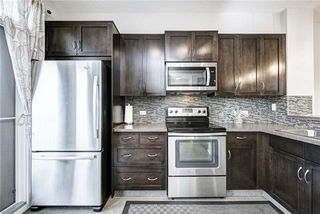 Photo 12: 71 EVANSVIEW Gardens NW in Calgary: Evanston Row/Townhouse for sale : MLS®# A1016799