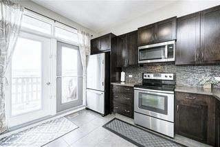 Photo 11: 71 EVANSVIEW Gardens NW in Calgary: Evanston Row/Townhouse for sale : MLS®# A1016799