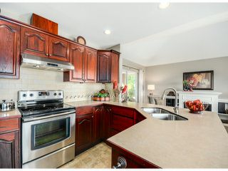 "Photo 8: 35957 STONERIDGE Place in Abbotsford: Abbotsford East House for sale in ""Mountain Meadows"" : MLS®# F1412668"