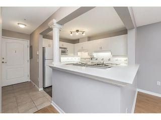 "Photo 7: 409 1669 GRANT Avenue in Port Coquitlam: Glenwood PQ Condo for sale in ""THE CHARLESTON"" : MLS®# R2270844"