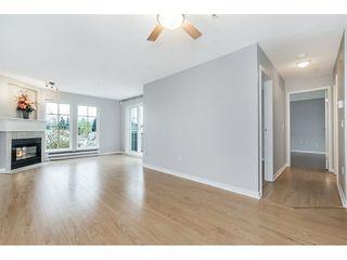 "Photo 4: 409 1669 GRANT Avenue in Port Coquitlam: Glenwood PQ Condo for sale in ""THE CHARLESTON"" : MLS®# R2270844"