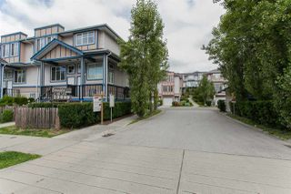 "Photo 1: 35 13899 LAUREL Drive in Surrey: Whalley Townhouse for sale in ""Emerald Garden"" (North Surrey)  : MLS®# R2376836"
