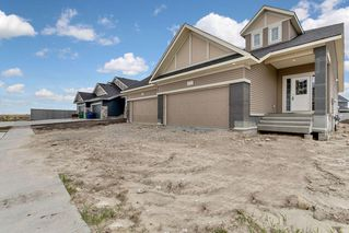 Main Photo: 1591 RAVENSMOOR Way SE: Airdrie Semi Detached for sale : MLS®# C4301437