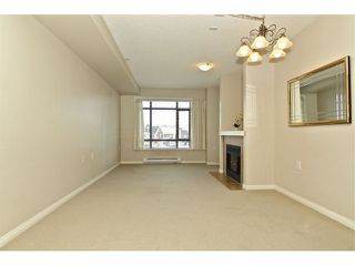 "Photo 5: 301 8880 202ND Street in Langley: Walnut Grove Condo for sale in ""THE RESIDENCES AT VILLAGE SQUARE"" : MLS®# F1409404"