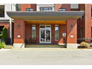 "Photo 3: 301 8880 202ND Street in Langley: Walnut Grove Condo for sale in ""THE RESIDENCES AT VILLAGE SQUARE"" : MLS®# F1409404"