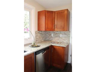 Photo 4: 1616 110 Avenue SW in Calgary: Braeside_Braesde Est House for sale : MLS®# C4031183