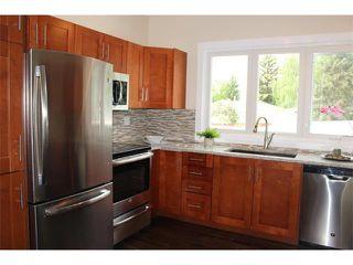 Photo 2: 1616 110 Avenue SW in Calgary: Braeside_Braesde Est House for sale : MLS®# C4031183