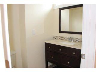 Photo 18: 1616 110 Avenue SW in Calgary: Braeside_Braesde Est House for sale : MLS®# C4031183